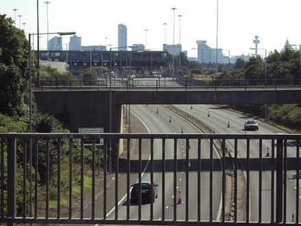 The Wallasey entrance to the Kingsway Tunnel. Liverpool's skyline is visible in the background Benkid77 Kingsway Tunnel Approach Road 2 090809.JPG
