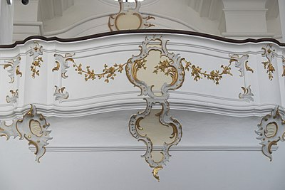 18th-century Rococo balcony, Bavaria. The form is itself ornamental, and further decorated in painted plasterwork Bergen bei Neuburg Heilig Kreuz 203.jpg