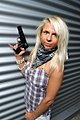 Blode woman with a plastic gun.jpg