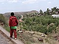 Boy with Town in Background - Lalibela - Ethiopia (8726003088).jpg