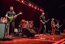 Breaking Benjamin performing in 2015. From left to right, Keith Wallen, Shaun Foist, Benjamin Burnley, Aaron Bruch, and Jasen Rauch.