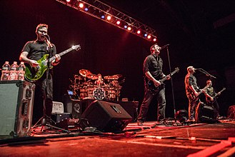 Breaking Benjamin - Breaking Benjamin performing in 2015. From left to right, Keith Wallen, Shaun Foist, Benjamin Burnley, Aaron Bruch, and Jasen Rauch.