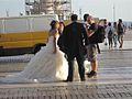 Bride and groom having pictures taken near Tejo (8048287773).jpg
