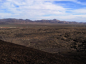 Bristol Mountains - Southeast end of Bristol Mountains as seen from Amboy Crater.  The town of Amboy can be seen on the right side of the image