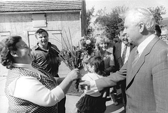 Yegor Ligachyov - Ligachyov (right) meets with German farmers in Neuzelle during a visit to East Germany in 1989.