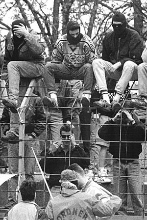 Football hooliganism - German football hooligans with masked faces in a 1990s match.
