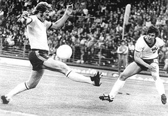 Doug Utjesenovic - Utjesenovic (left) facing East Germany's Eberhard Vogel at the 1974 FIFA World Cup.