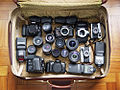 Cameras and lenses in a suitcase.jpg