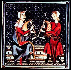 "Odrecillo - An illumination from the 13th Century Cantigas de Santa Maria, showing small droneless bagpipes, labeled in some sources as ""odrecillo""."