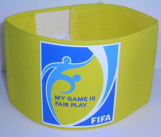 "Captain (association football) - A captain's armband with FIFA's ""My Game is Fair Play"" slogan printed on it."