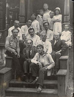 Der Nister - Der Nister (front center) sitting behind Marc Chagall at the Malakhovka Jewish boys refuge.