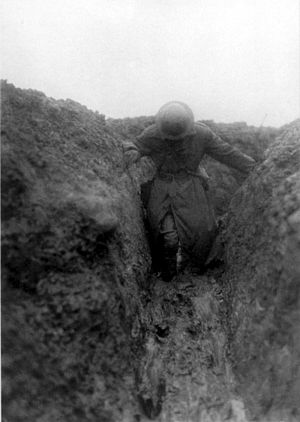 Charles Bean - Bean in the mud of Gird Trench near Gueudecourt, Somme, France, during the winter of 1916—17