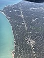 Chicago and Lake Michigan from the window seat (34002827568).jpg