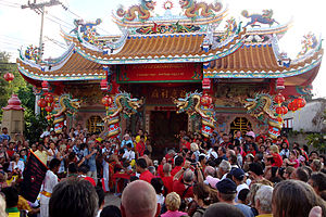 Religion in Thailand - People flock to the Maenam Temple for Chinese New Year, in Koh Samui.