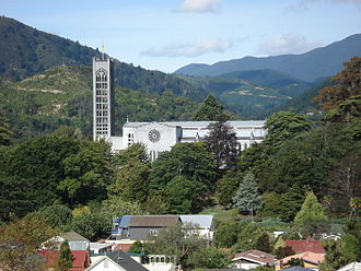 """Christ Church Cathedral, Nelson - Christ Church Cathedral looking east. """"Centre of New Zealand"""" visible to the left of tower."""