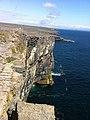 Cliffs and blue Atlantic, Dún Aonghasa (6024263472).jpg