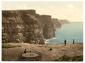 Cliffs of Moher - A 19th-century Photochrom postcard of the cliffs, with Leacmayornagneeve rock in the foreground