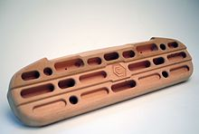 A wooden hangboard designed for increasing contact strength
