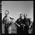 Crewmen watch Navy plane returning to USS Lexington (CV-16) after strike against Japs on Mili. - NARA - 520906.tif