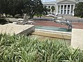 Curtis L Waller Park dolphin statues from level above with Supreme Court of Florida.JPG