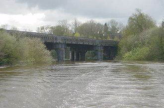 Dee Bridge disaster - Modern railway bridge in Chester, spanning the river between Curzon Park and the Roodee. Photo taken at high tide.