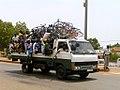 Cyclists on truck in Burkina Faso, 2009.jpg
