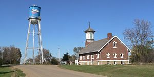 Dallas, SD, St. Augustine and water tower from S 1.JPG