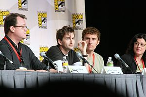 David Tennant - Tennant with Doctor Who showrunner Russell T Davies (left), regular director Euros Lyn (centre right), and executive producer Julie Gardner (right) at San Diego Comic-Con International in July 2009