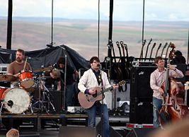 Decemberists playing live daylight.jpg
