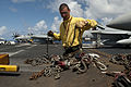 Defense.gov News Photo 110816-N-BT887-045 - U.S. Navy Petty Officer 2nd Class Adam Zimniak collects chains removed from an F A-18E Super Hornet aircraft aboard the aircraft carrier USS John.jpg