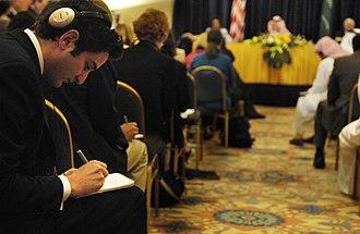 Guy Raz - Raz taking notes at a press conference in Saudi Arabia, 2007