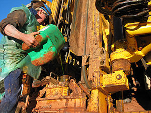 Drilling fluid - Driller pouring anti-foaming agent down the rod string on a drilling rig