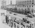 Distance view of President Truman riding in his limousine to the reviewing stand for the inaugural parade. - NARA - 200037.tif