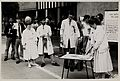 Doctors and nurses at demo. Cake cutting '40 years' NHS. Wellcome L0075367.jpg