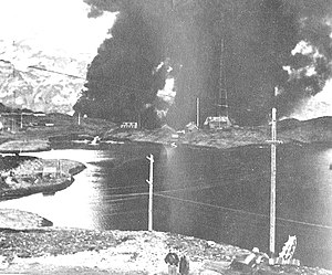 Aleutian Islands Campaign - The Navy radio station at Dutch Harbor burning after the Japanese Attack, 4 June 1942