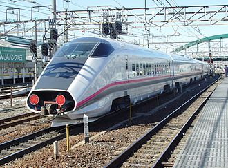 E3 Series Shinkansen - Set R20 being hauled through Omiya Station on delivery in March 2003