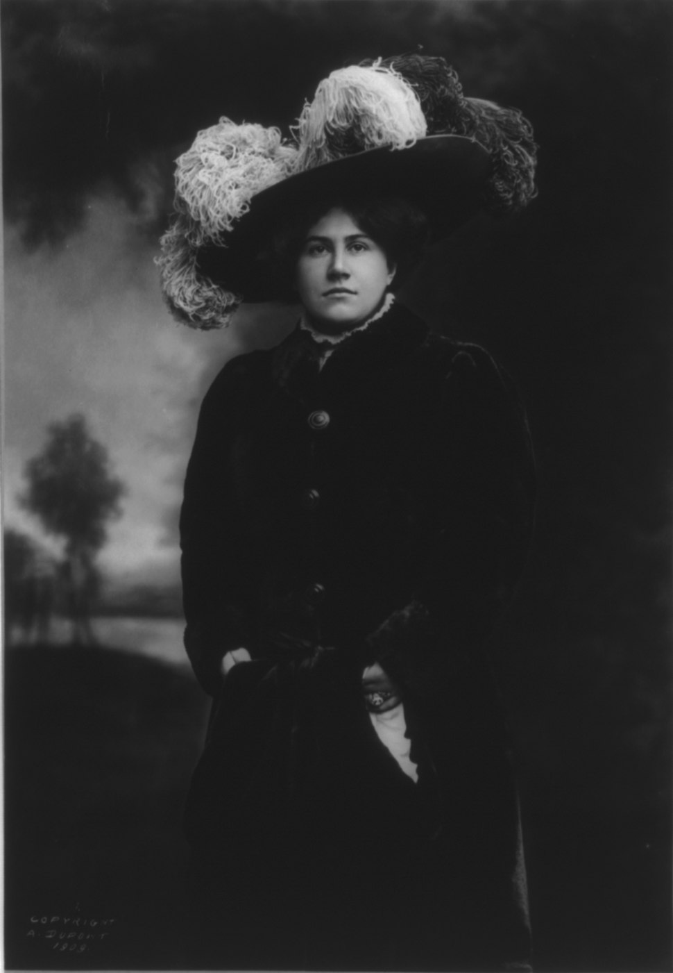 Emmy Destinn, 1878-1930, three-quarters length portrait, standing, facing left, wearing fur hat