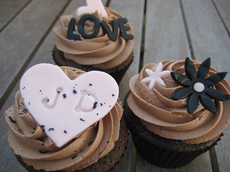 File:Engagement cupcakes with chocolate frosting and pink decorations ...