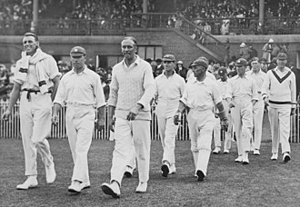 Arthur Gilligan - Gilligan (third from left) is leading the England team onto the Melbourne Cricket Ground at the Australian second innings during the fourth Test on 18 February 1925.