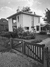exterieur overzicht woonhuis (linker zijgevel en voorgevel) met ingangshek(je) - utrecht - 20001519 - rce