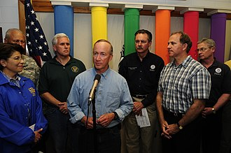 Mitch Daniels - Governor Daniels addresses state and federal assistance available to tornado and flood victims with then Congressman Mike Pence, FEMA Administrator R. David Paulison