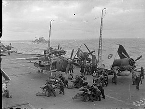 Operation Goodwood (naval) - Image: Fairey Barracuda and Vought F4U Corsair aircraft being armed on board HMS Formidable