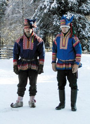 Gákti - Two Finns dressed up in fake gákti outside of Rovaniemi, Finland. Though at first glance authentic, the patterns on these gáktis are not traditional anywhere in Sapmi