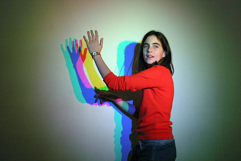 Female in red pullover and blue jeans -coloured lights-2Nov2003