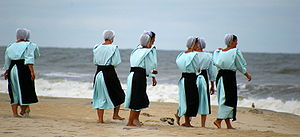 Modesty - Modesty in dress is a relative cultural concept, even in the West, as seen above in the dresses of Amish women on an American beach in 2007.