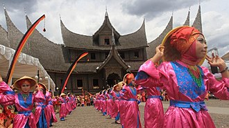 Islam in West Sumatra - Minangkabau adat festival. Note the addition of hijab to the traditional costume