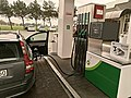 Filling station refueling a car.jpg