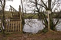 Footbridge over River Eamont with sign - geograph.org.uk - 936526.jpg