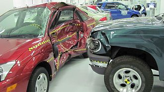 Side collision - A crash test by the Insurance Institute for Highway Safety shows the damage to a compact Ford Focus struck by a Ford Explorer SUV