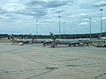 Four Jetstar A320s at Melbourne Airport in Dec 2012.JPG